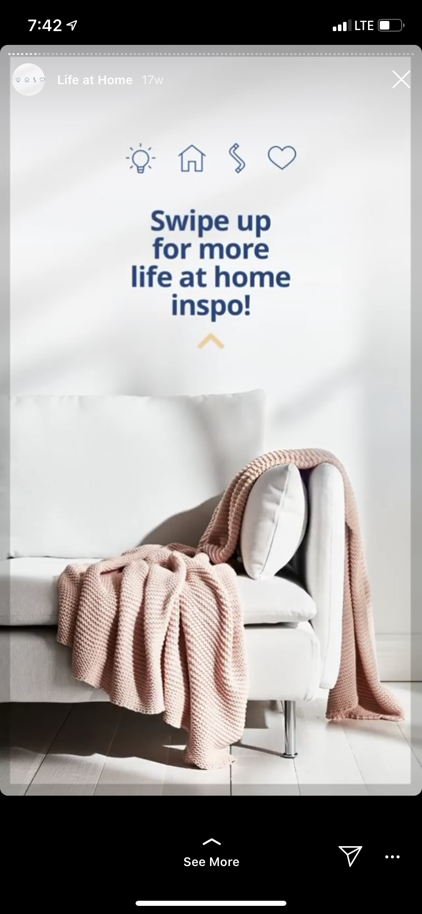 """Ikea instagram story photo featuring a white couch with a pink throw blanket. Text reads: """"Swipe up for more life at home inspo"""""""